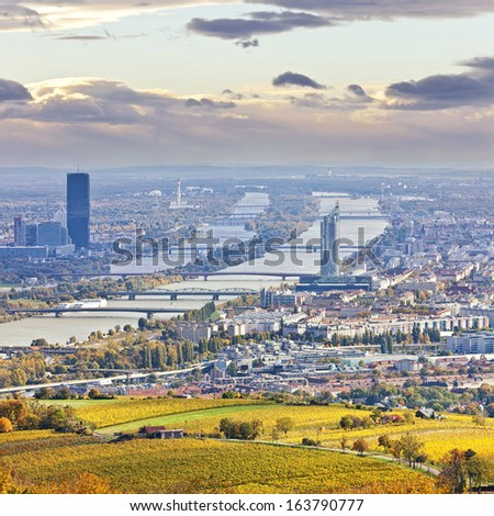 Cityscape of Vienna and Danube in the autumn at dusk. At the Right the so called Millenium Tower, at the left the Danube City with its new DC Tower. Airport Vienna and its Control Tower in the back. - stock photo