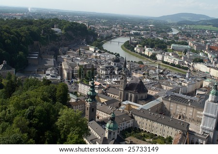 Cityscape shows Salzburg with river going across it, tilted horizon adds dynamics to the scenery - stock photo