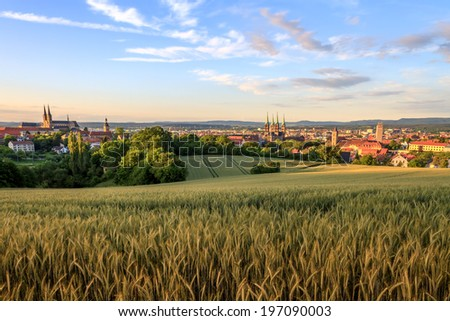 Cityscape View on the old churches of the old german medieval city of Bamberg on a sunset in Summer - stock photo