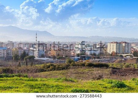 Cityscape with modern buildings under blue cloudy sky. Izmir city, Turkey - stock photo