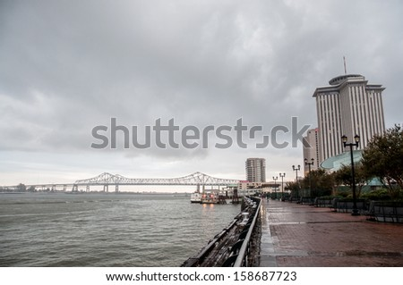 cityscape with New Orleans bridge - stock photo