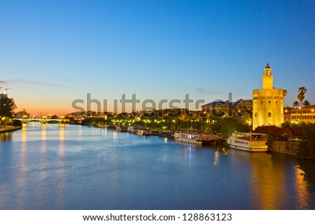 cityscape with river of Sevilla at night, Spain - stock photo