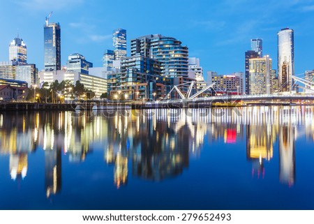 Cityspace of Dockland in Melbourne at sunset with reflection - stock photo