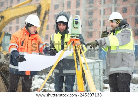 Civil Engineers At Construction Site In Winter Season - stock photo