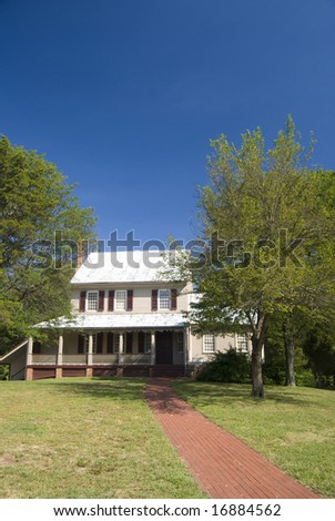 Civil War era house on a Virginia farm, with path leading up to it - stock photo