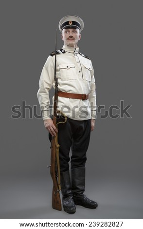Civil War in Russia, Russian Civil War 1918-1922, White Guard, Trooper of 1st General Markov (Markoff) Officers Regiment. Isolated on grey background. - stock photo