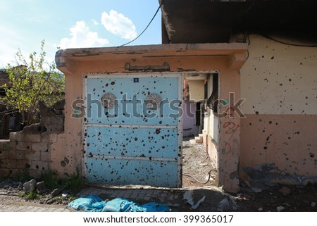 CIZRE, SIRNAK - MARCH 30: A building is seen just after it was hit during clashes between Kurdish protesters and Turkish police. The Photo Taken March 30, 2016. - stock photo