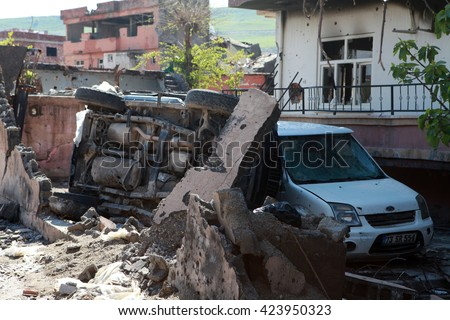 CIZRE, SIRNAK - MARCH 30: Cizre is seen just after it was hit during clashes between Kurdish protesters and Turkish police. The Photo Taken March 30, 2016. - stock photo