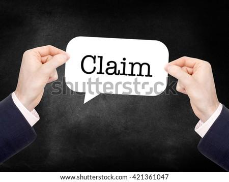 Claim written on a speechbubble - stock photo