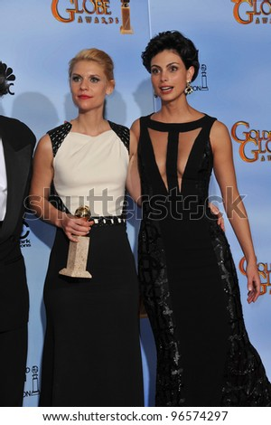 Claire Danes & Morena Baccarin (right) at the 69th Golden Globe Awards at the Beverly Hilton Hotel. January 15, 2012  Beverly Hills, CA Picture: Paul Smith / Featureflash - stock photo