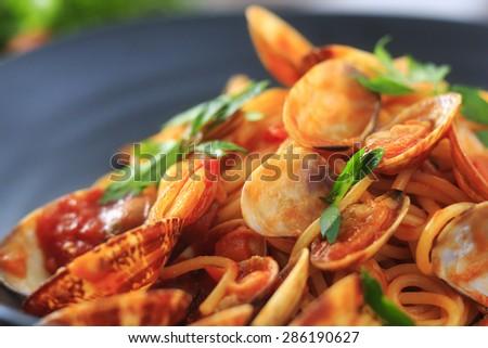 Clam and tomato sauce spaghetti - stock photo