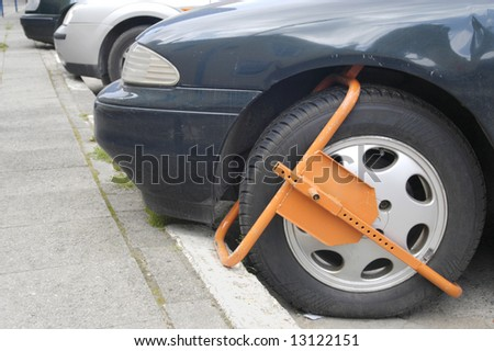 Clamped front wheel in restricted area - stock photo