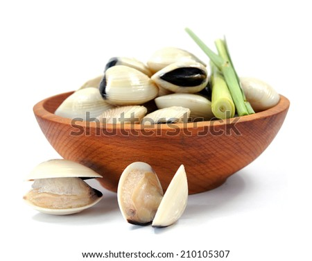 clams and lemon grass on wooden bowl  - stock photo