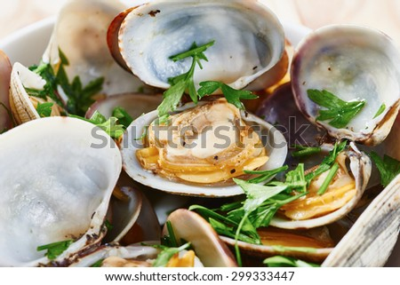 Clams steamed in white bowl close up - stock photo
