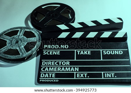 Clap cinema, metal or plastic reel of film. Objects for shooting movies and demonstrations - stock photo