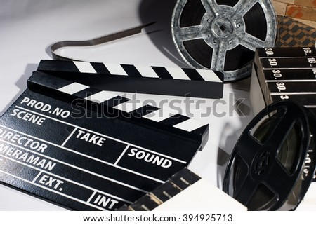 Clap cinema on the table. Two reels of film - stock photo