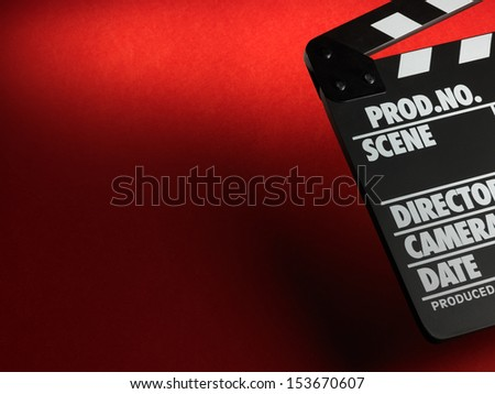 Clapper board on red background - stock photo