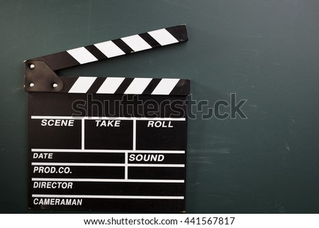clapper board on the blackboard - stock photo
