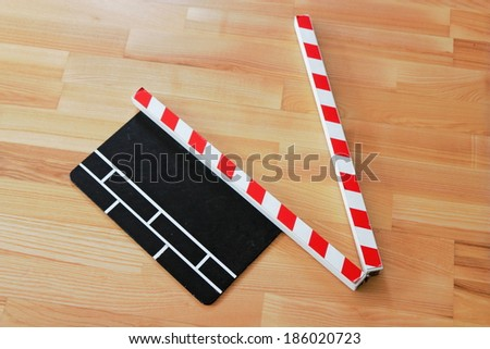 Clapperboard on parquet - stock photo