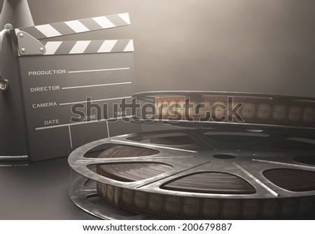Clapperboard with rolls of film in the retro concept cinema. - stock photo