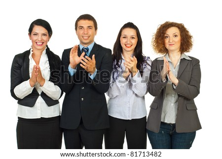 Clapping happy business people standing in a row isolated on white background - stock photo