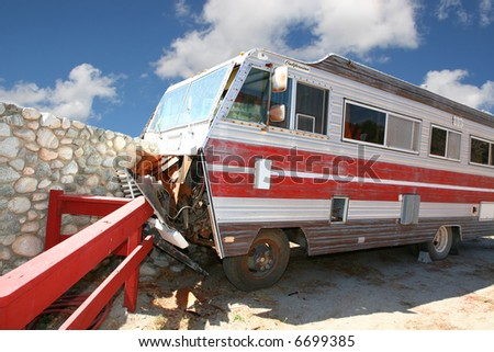 Class A RV Coach That Crashed Into A Stone Wall - stock photo