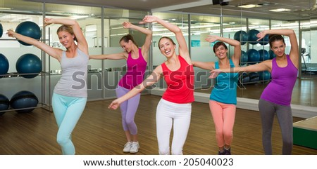 Class dancing in studio at the gym - stock photo