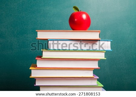 Class. Education symbol of apple and stack of books in class - stock photo