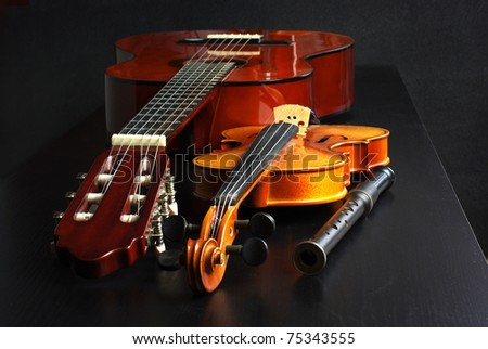 Classic acoustic guitar, violin and wooden flute - stock photo