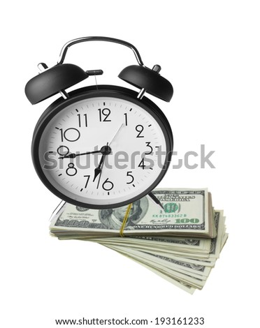 Classic alarm clock and dollar bills, time and money, concepts and ideas - stock photo