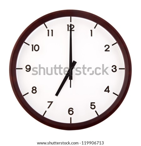 Classic analog clock pointing at 7 o'clock, isolated on white background - stock photo