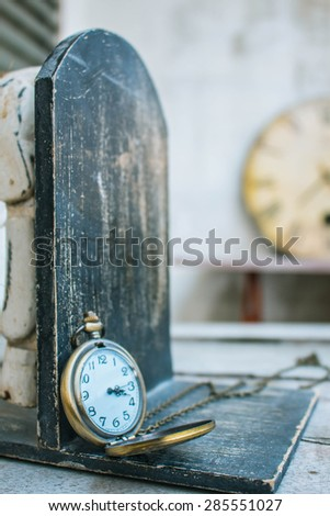 Classic antique clock on wood. - stock photo