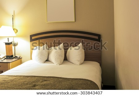 Classic Bedroom Interior with King Size Bed and Line of Arranged Pillows. Evening Time Bedroom.Horizontal Composition - stock photo