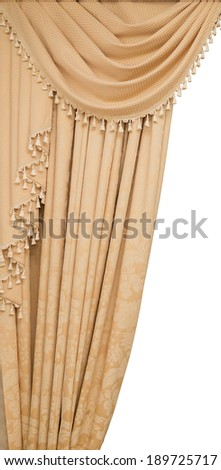 classic beige curtain hanging on a window - stock photo