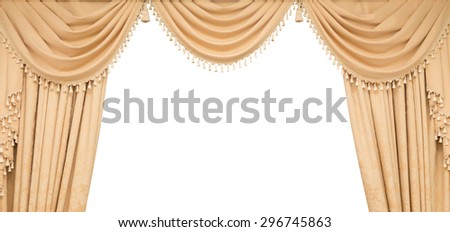 Classic beige curtains hanging on a window, isolated on white - stock photo