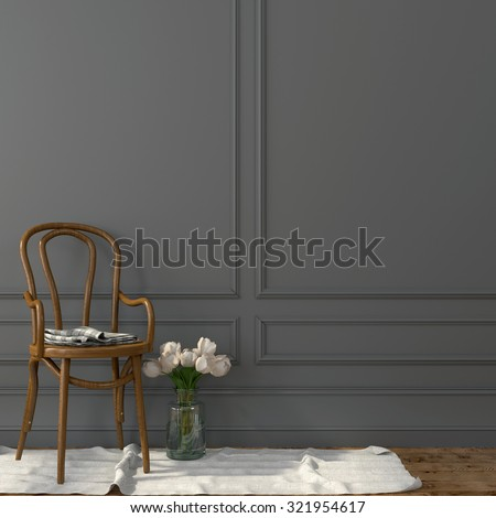 Classic bent wooden chair against a background of gray wall - stock photo