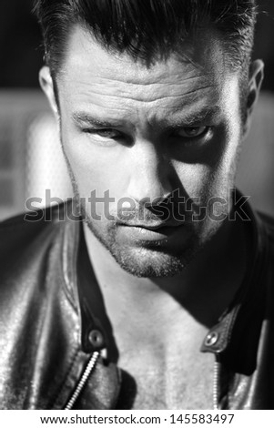Classic black and white fine art portrait of a handsome tough guy - stock photo