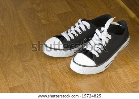 Classic black and white sneakers. - stock photo