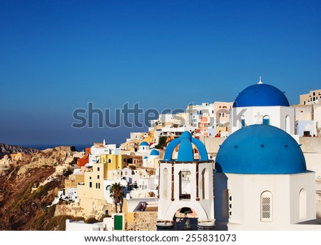 Classic blue dome churches in Santorini. Oia Village, Greece. - stock photo