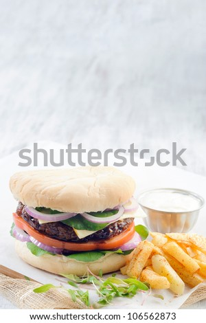 Classic burger with bbq beef patty chips french fries - stock photo