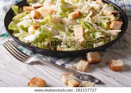 Classic Caesar Salad close-up on a plate. Horizontal  - stock photo