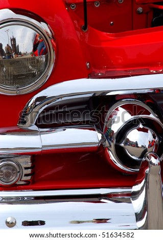 Classic candy apple red vintage car headlight - stock photo