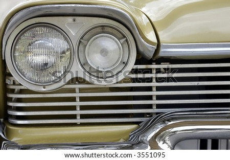 Classic Car Grille and Headlight - stock photo