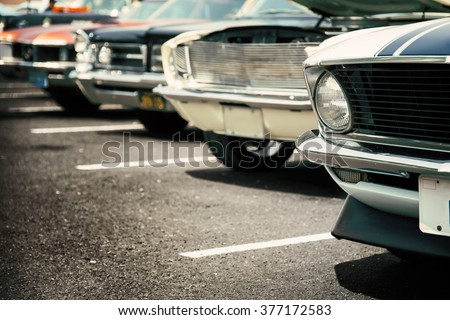 Classic cars in a row - stock photo