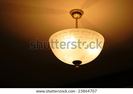 classic chandelier in the hotel, ceiling lamp in the room - stock photo