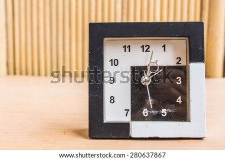 Classic clock on a wooden background. - stock photo