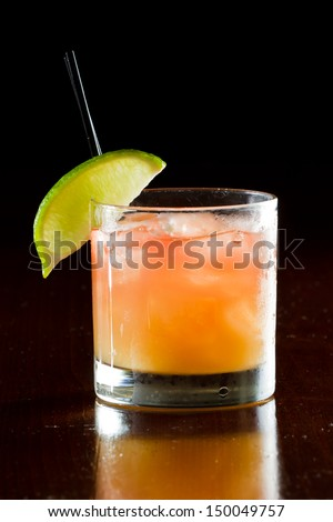 classic cocktail, madras, vodka cranberry and orange juice served in a glass on a dark bar - stock photo