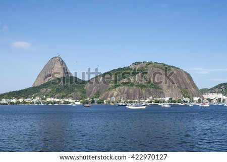 Classic daytime scenic profile view of Pao de Acucar Sugarloaf Mountain in Rio de Janeiro, Brazil standing above Botafogo Bay - stock photo