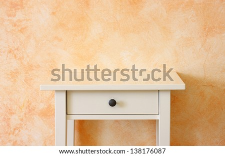 classic empty drawer near terracotta textured wall. room for copy space. - stock photo