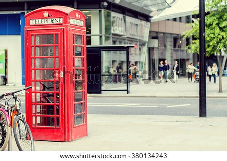 Classic english red telephone booth in London, UK. Image with selective focus and toning. - stock photo